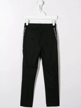 Givenchy Kids - logo pleated trousers 65069B95383603000000