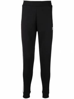 Adidas - спортивные брюки с тремя полосками 55993356693000000000