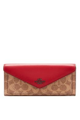 Красно-бежевый кошелек с монограммами Coach 2219156556